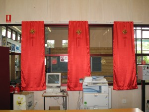 Red satin Banners with decorations in front