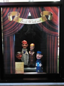 Punch and Judy Puppets holding book week books