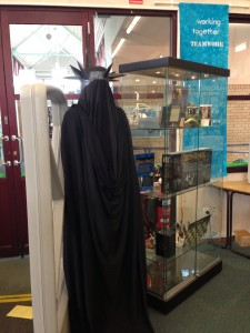 photo of the back of the witch king costume and the back of the display cabinet.