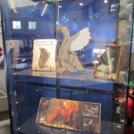 Contents of the display cabinet containing the Goose Puppet, Handspring puppet book and the program from the play