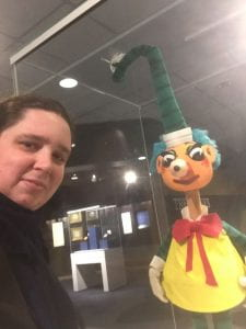 Miss H with Mr Squiggle puppet at the Australian Mint exhbition