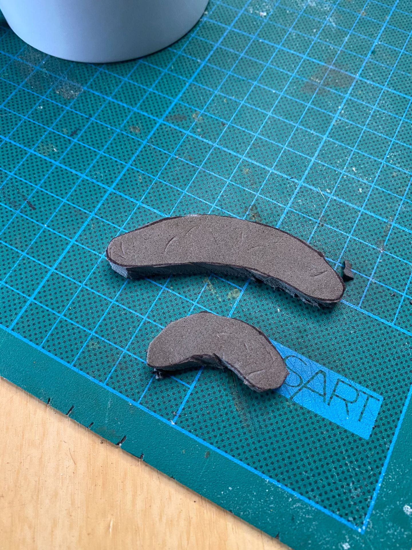 2 black foam peanut shapes